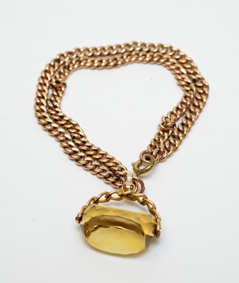 Lot 14 - An antique 9ct gold watch chain bracelet with citrine fob seal charm.