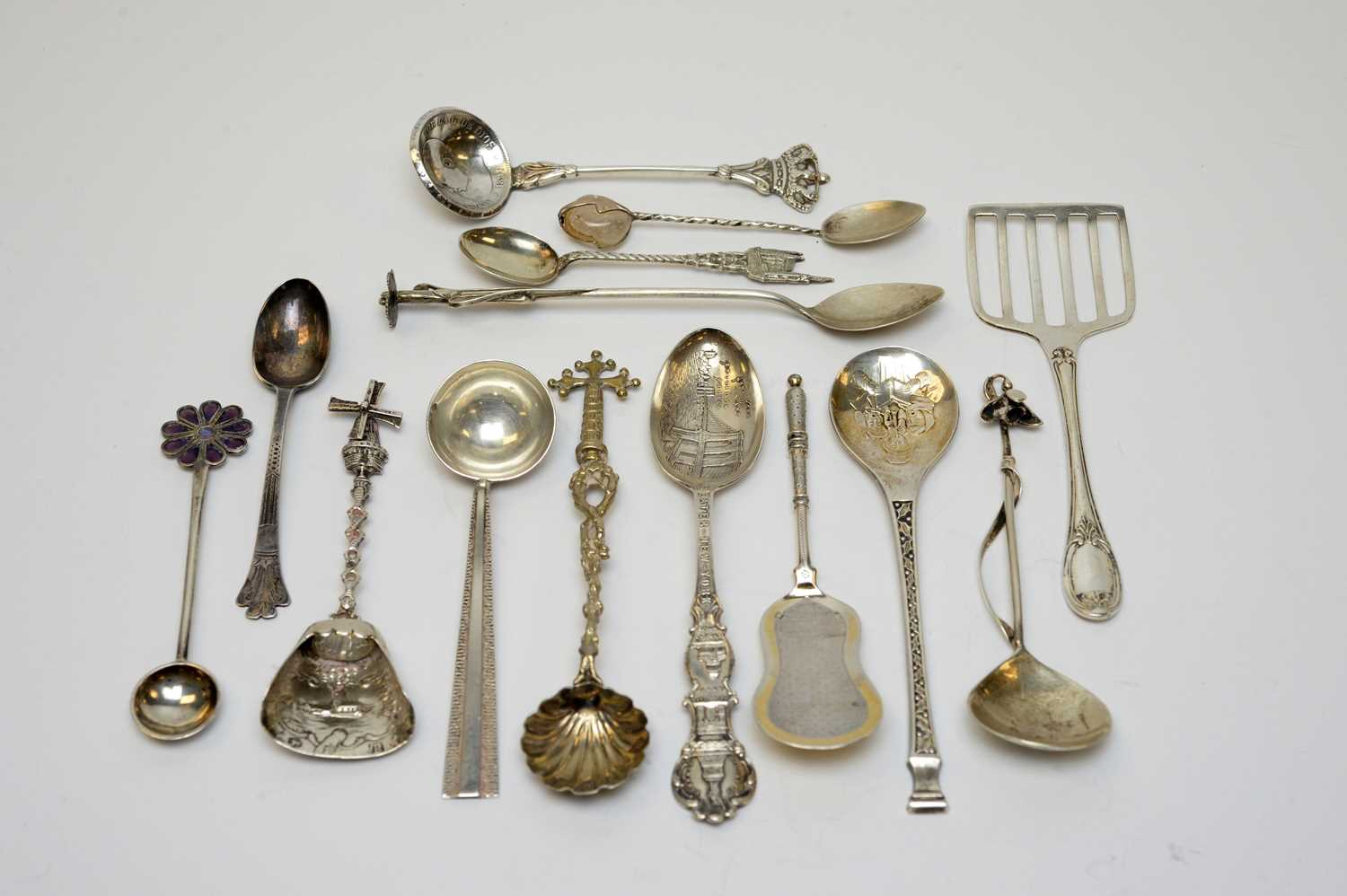 Lot 94 - A selection of British and continental silver spoons.