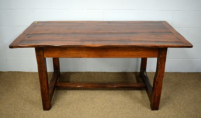 Lot 89 - An oak refectory style table; and a set of six dining chairs in a rustic 19th style.