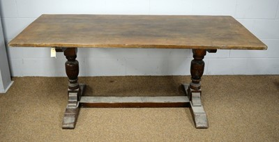 Lot 53 - A 20th Century oak refectory dining table.