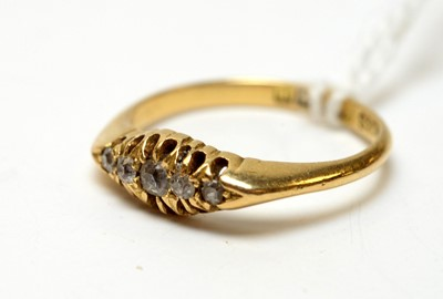 Lot 13 - An antique 18ct gold and five stone diamond ring.