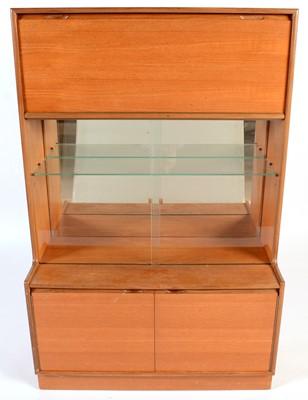 Lot 83 - Turnidge of London Ltd: a mid Century teak mirror-backed display cabinet.