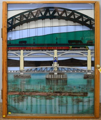 Lot 1230 - A large glass collage depicting Newcastle Bridge and the rail line