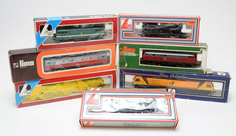 Lot 627 - Eight boxed LIMA HO-gauge model trains.