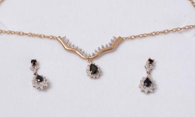 Lot 258 - A contemporary sapphire and diamond demi-parure.