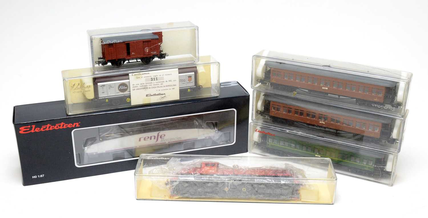 Lot 649 - Seven boxed Electrotren HO-gauge trains, carriages, and rolling stock.