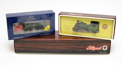 Lot 650 - Three boxed Liliput locomotives and rolling stock.