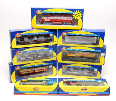 Lot 657 - Nine Athearn trains and rolling stock.
