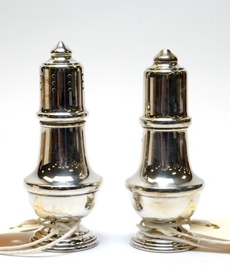 Lot 78 - A pair of Elizabeth II silver salt and pepper pots.