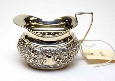 Lot 85 - An Edwardian silver cream jug.