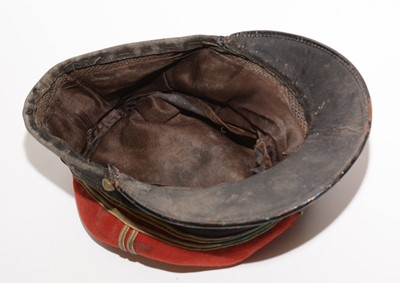 Lot 1062 - A late 19th/early 20th Century French Grenadier's Kepi