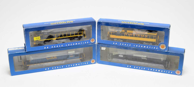 Lot 694 - Four Bachmann HO-gauge boxed trains.