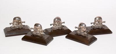 Lot 1195 - A set of five George V Royal Lancers silver menu stands