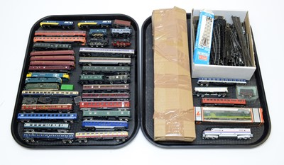 Lot 764 - Unboxed N-gauge trains, carriages and rolling stock; and a qty. of track.