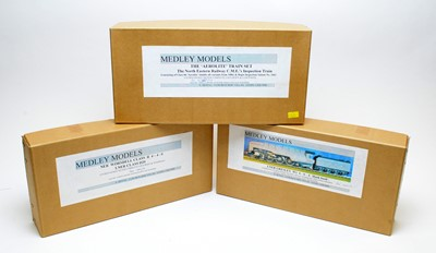 Lot 784 - Three boxed Medley model train kits.