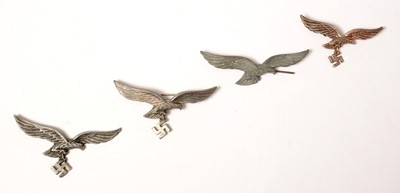 Lot 1028 - Three WWII German Luftwaffe breast badges and a repro cap badge