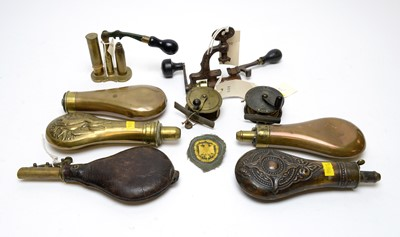 Lot 1083 - 19th Century powder and shot flasks, and two fishing reels.