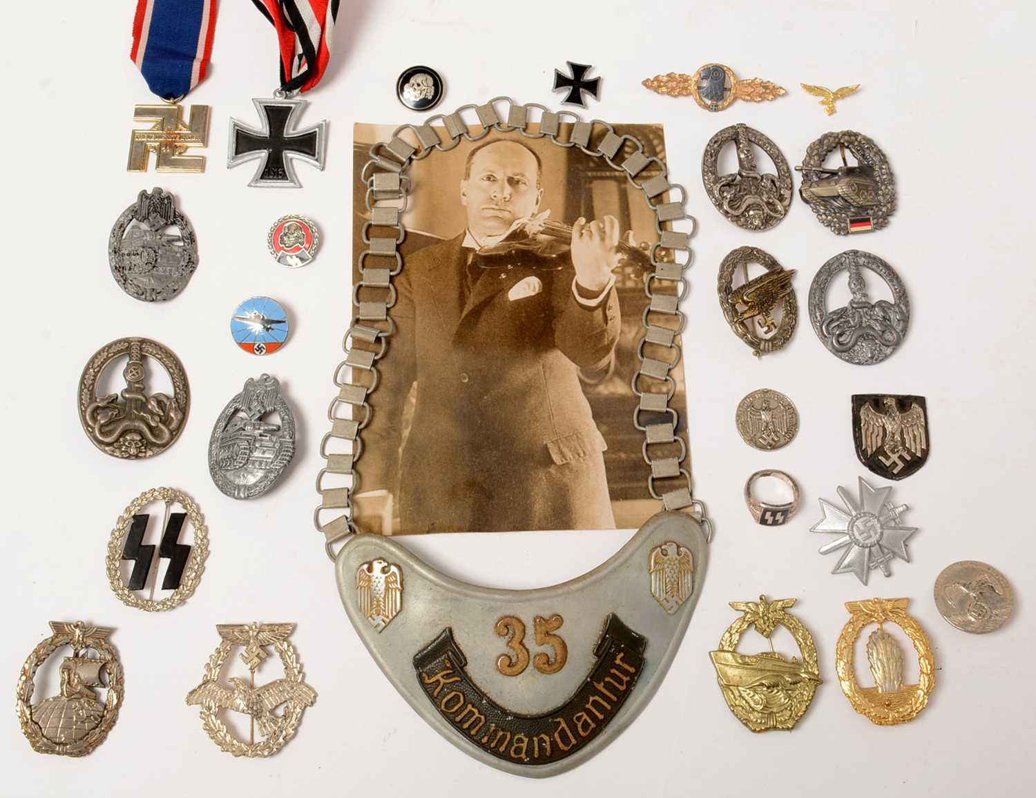 Lot 1026 - A Collection of reproduction WWII German award badges and medals etc