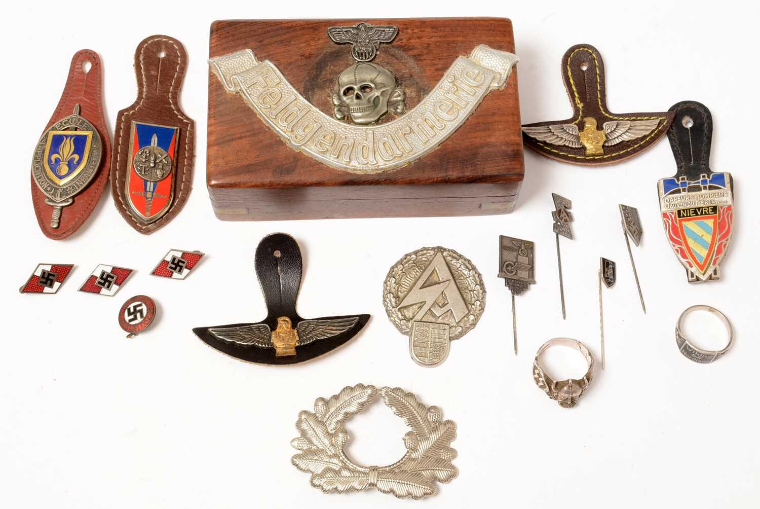 Lot 1037 - A collection of WWII and later German badges and buttons