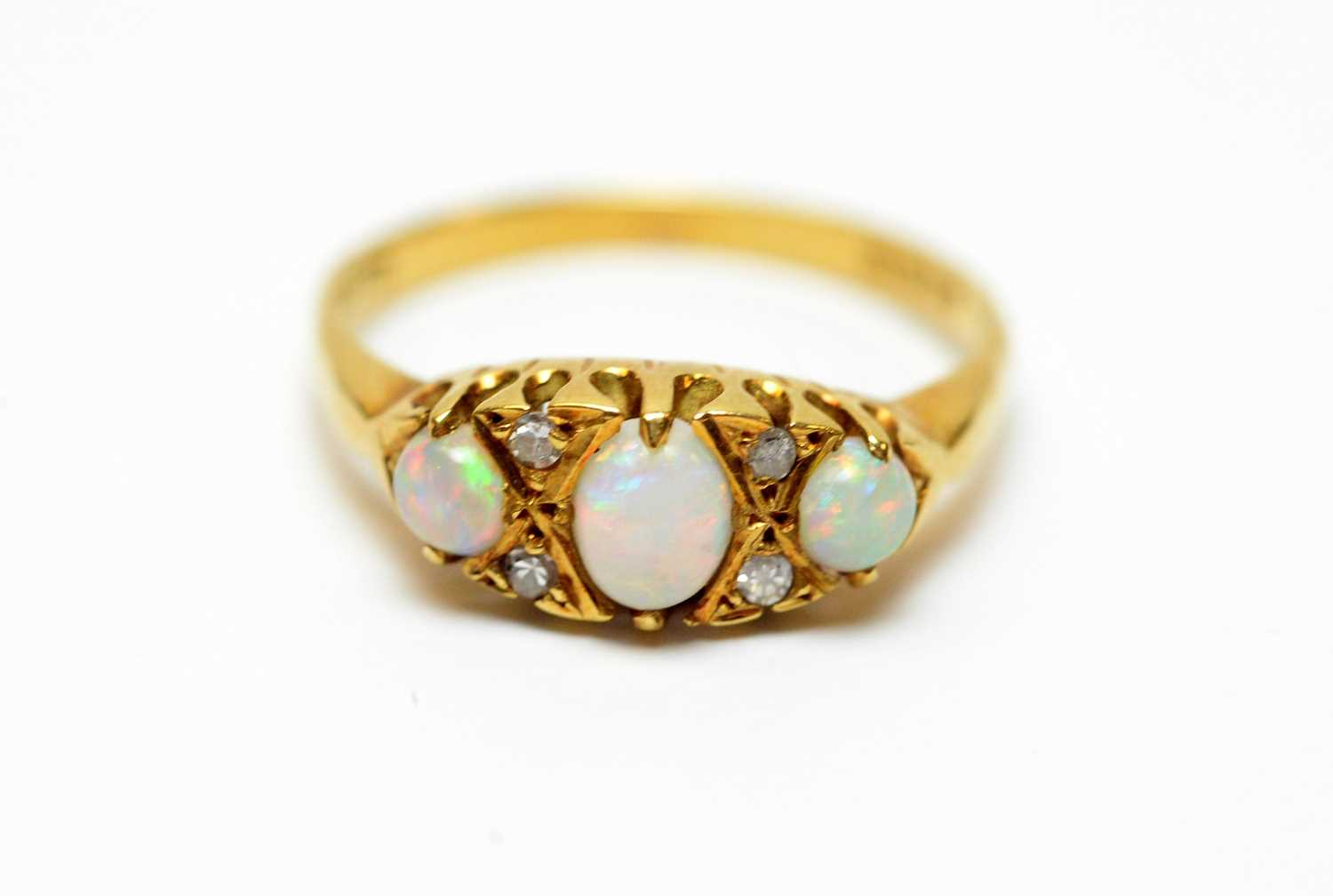 Lot 9 - An 18ct gold, diamond and opal dress ring.