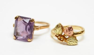 Lot 10 - Four gold dress rings.