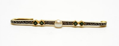 Lot 18 - A Belle Epoque pearl, emerald and diamond bar brooch.