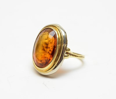 Lot 24 - A citrine and high-carat white and yellow metal cocktail ring.