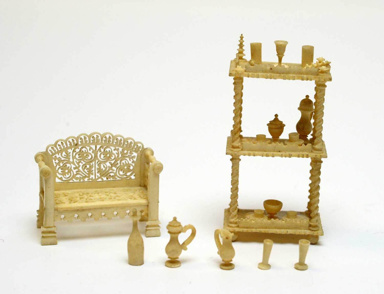 Lot 34 - 19th Century carved ivory miniatures.