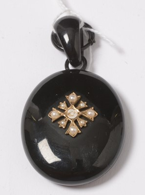 Lot 263 - A Victorian jet and seed pearl pendant locket.