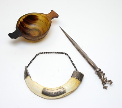 Lot 41 - Antique horn quaich, letter opener, and whiskey decanter label.