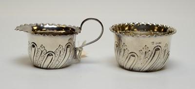 Lot 44 - A Victorian silver milk jug and sugar bowl.