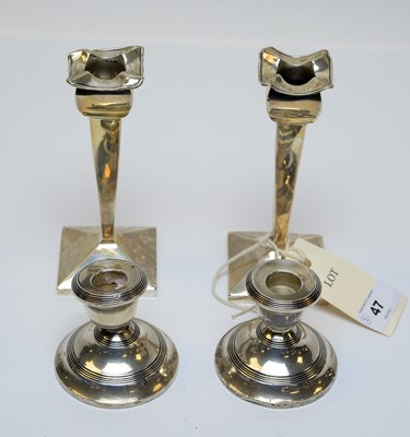 Lot 47 - Two pairs of antique silver candlesticks.