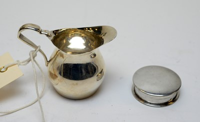 Lot 62 - A Victorian silver jug, and a silver pill box.