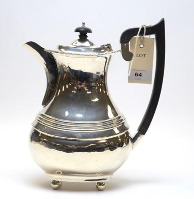 Lot 64 - A George V silver coffee pot.