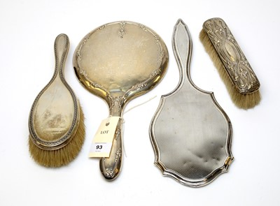 Lot 93 - Antique silver hand mirrors, hair, and clothes brushes.