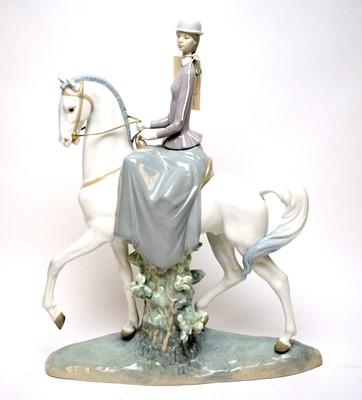 Lot 255 - A Lladro equestrian figure group