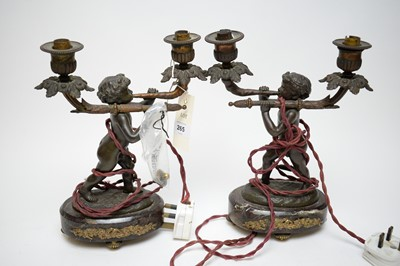 Lot 265 - Pair of bronzed two-branch figural table lamps