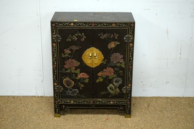 Lot 48 - An Asian black lacquered two door cabinet.