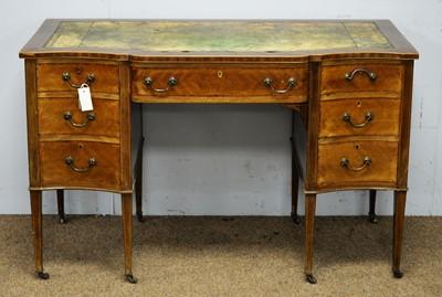 Lot 31 - An Edwardian inlaid mahogany breakfront desk.