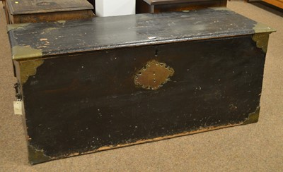 Lot 24 - A 19th Century ebonised and brass-bound trunk.