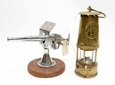 Lot 517 - Eccles brass miners lamp and another