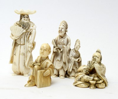 Lot 519 - Four Japanese ivory netsuke