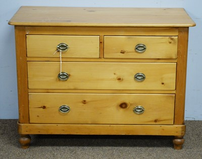 Lot 3 - A Victorian stripped pine chest of drawers.