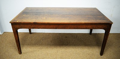 Lot 16 - A substantial 18th C style oak plank top dining table.