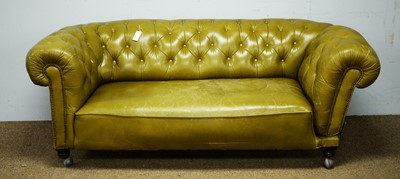 Lot 6 - A late Victorian green buttoned and studded leather drop-end Chesterfield sofa.