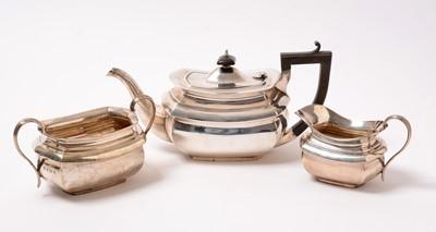 Lot 196 - A George V silver three-piece tea service.
