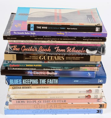 Lot 324 - 18 Guitar reference books and catalogues