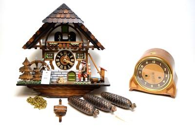 Lot 311 - German cuckoo clock; and an Art Decom domed mantel clock.