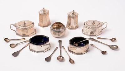 Lot 192 - A George V six-piece Art Deco silver cruet set, a napkin ring, and spoons.