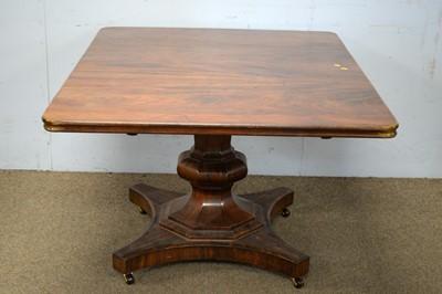 Lot 75 - A Victorian mahogany rectangular tilt-action dining table.